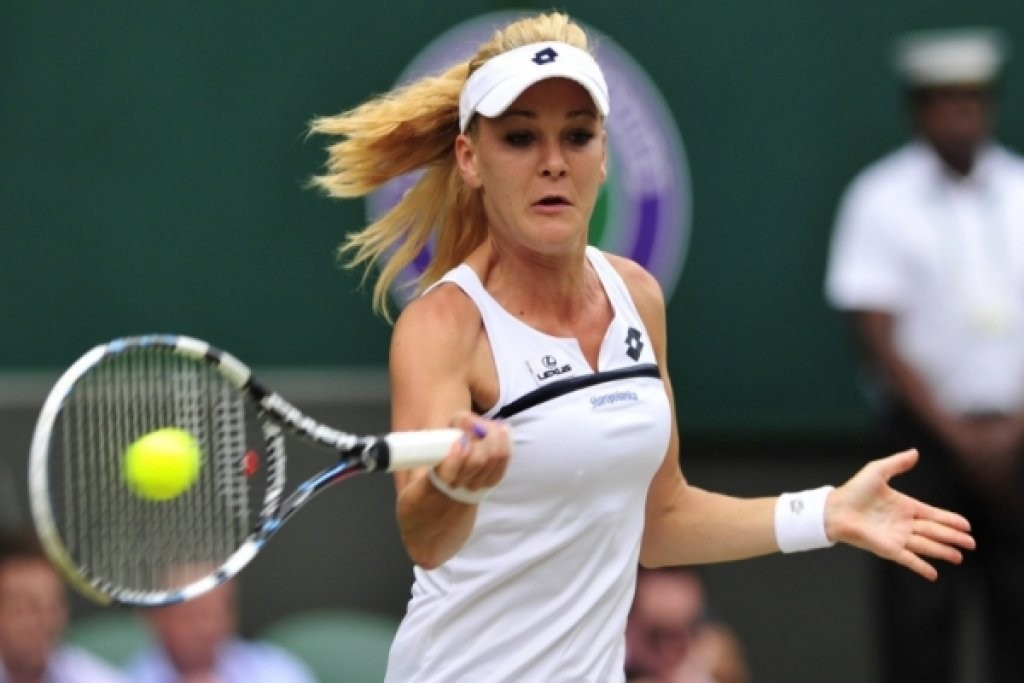 TENNIS-GBR-WIMBLEDON...Poland's Agnieszka Radwanska returns against Germany's Sabine Lisicki during their women's singles semi-final match on day ten of the 2013 Wimbledon Championships tennis tournament at the All England Club in Wimbledon, southwest London, on July 4, 2013.  AFP PHOTO / GLYN KIRK  -  RESTRICTED TO EDITORIAL USE        (Photo credit should read GLYN KIRK/AFP/Getty Images)